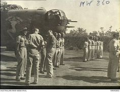Fenton, NT. c. July 1944. Empire Parliamentary Delegation representatives talking with members of mixed RAAF and US Army Air Force (USAAF) air crews who flew Consolidated B24 Liberator bomber ...