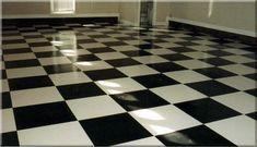 Black and white checkerboard epoxy concrete floor treatment
