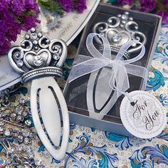 unique silver cross place card holders for wedding favors and decor that your guest can take home and use as photo holders dream wedding pinterest