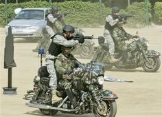 U.S. soldiers operating from military Harley Davidson bikes...Get em boys!!