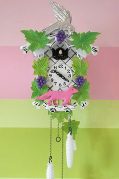House Crashing: Perky & Personal | Young House Love Repainting an old cuckoo clock to make it playful and fun!