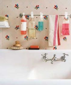 Towel Rod as Cleaning Supply Holder  Assemble a spray-cleaner arsenal by installing a rod in the closet or underneath the sink and then hooking the bottles onto it by their trigge