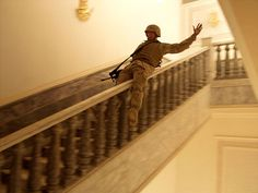 April 14, 2003: A Marine tries the banister at a palace in Saddam's hometown of Tikrit. Ashley Gilbertson/VII