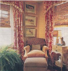 vertical art. patterned curtains. cozy chair and footstool. bamboo blinds. wall color