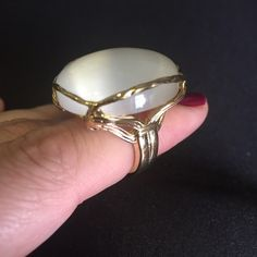 EUC Ariella Round Cats Eye Statement Cabochon Ring Worn twice beautiful ring from Ariella Collection. Basket of twisted gold tone metal secures a smooth cabochon to lend brilliant shine to a round statement ring.  One size fits all. Ariella Collection Jewelry Rings