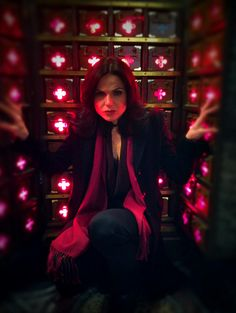 "Adam Horowitz: ""Another #OnceUponATime photo by director Billy Gierhart. Lana Parrilla hard at work! Hope to see ya March 1!"" Such a great pic and an intriguing setting, wonder why all of the hearts are glowing"