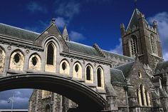 Christ Church Cathedral, Dublin: built by Anglo-Norman conquerors between 1172 and 1220, restored in 1870 and bridge added to connect it with the Synod Hall. The central nave rises 82 ft. high.