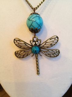 Dragonfly Necklace by joytoyou41 on Etsy, $25.00  I don't need another dragonfly pendant but did I need them all to begin with???  :D