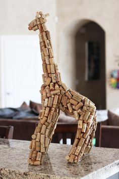 Wine Cork Giraffe Sculpture. This huge wine cork sculpture was created using just corks, newspaper and wire hangers. It makes a great decor for your bar area.