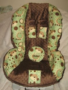 green and brown monkey carseat