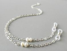 Items similar to Luxury Pearl Eyeglass Chain - Pearl Glasses Chain - Eyeglass Holders Necklaces - Silver Eyeglass Necklace - Eye Glass Chain - Glasses Holder on Etsy Nail Polish Flowers, Beaded Jewelry, Handmade Jewelry, Beaded Lanyards, Eyeglass Holder, Imitation Jewelry, Fashion Face Mask, Pearl Beads, Silver Necklaces