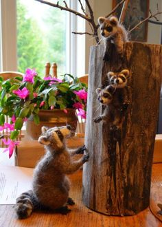 Felted Raccoon Family by Michelle Houston featured on www.livingfelt.com/blog