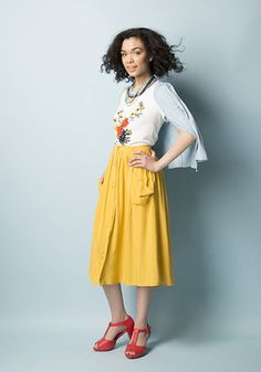 You always feel perfectly lovely in this dandelion-yellow midi skirt - and rightfully so! With softly draped side pockets, a belt-looped waistband, and a button-up silhouette, this versatile A-line adds a sunny perspective to any ensemble.