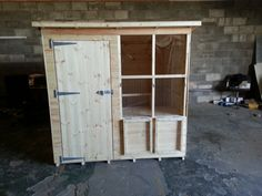 Perspex shutters open on a 6x4ft rabbit shed.