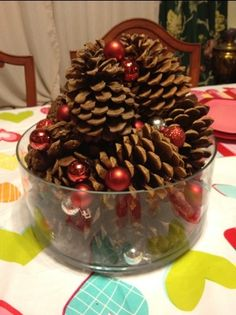 Valentine table centerpiece.  Easy DIY with pine cones and small red and silver Christmas balls