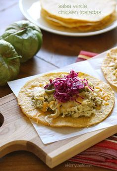 Chicken tenders are slow cooked in the crock pot with salsa verde, then served on a crispy corn tostada and topped with melted cheese, jalapeño and a simple cabbage slaw made with red cabbage, lime juice, cilantro and salt.