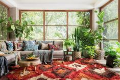 Let's add emerald green, crisp white and bundle of plants that add an earthy and lively personality to your living room. Adding bohemian chic cushions, pillows and poufs are making this place an appealing one for the first sight. The use of comfortable and colorful is also exceptional decorating item as shown in the picture given below.