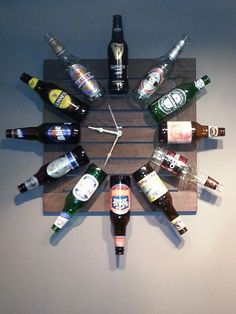 Beer Bottle Clock!  Old table top... 12 of your favorite beer brands... some industrial adhesive... and a clock movement kit!