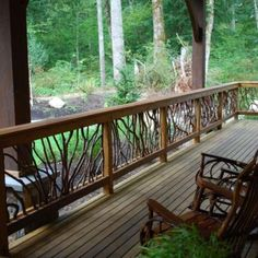 tree branch railing...what I'd like around the deck Wow this is nice