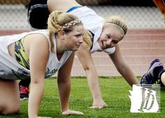 """Spring Grove High School junior Jenifer Hersh, left, and freshman Samantha Richards react to """"mountain climber"""" exercises during field hockey practice at Papermaker Stadium Monday, August 12, 2013. Monday is the first day of high school fall sports practice in the YAIAA. Bill Kalina photo bkalina@yorkdispatch.com"""