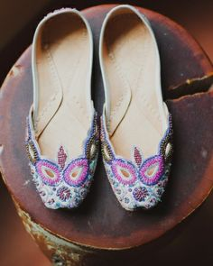 this bride wore hand-beaded indian wedding slippers to add a pop of colour to her dress