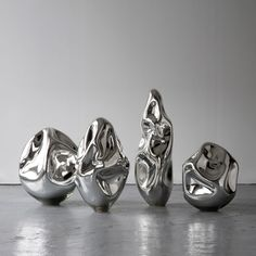 Jeff Zimmerman, USA, 2011  Unique dented sculptures in hand-blown silver mirrorized glass.