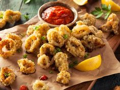 Preparing calamari in your oven is a great alternative to simply deep frying them. Filled with flavor, this seafood recipe is definitely an appetizer to enjoy alongside a slice of pizza. Feel free to serve with warm marinara sauce.