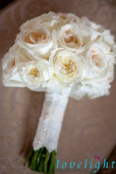 Gorgeous lighting on these ivory and cream garden roses with a lace detail on the trim of the stems