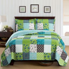 Country Cottage Patchwork Blue Green Patchwork Microfiber Quilt Coverlet and Shams Set Oversized. Bedding set features a multicolor patchwork pattern and is reversible to a coordinating color.