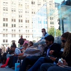 """Fans Already Lined Up at NY Apple Store for iPhone 5 (I'm sorry but anyone who loves computers enough to sleep on concrete for over a week, just to be """"the first"""" to get it is nerd and half.)"""