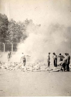 Auschwitz, Poland, Bodies being burned by the Sonderkommando, summer of 1944. The photo was taken clandestinely by members of the Sonderkommando. Former Sonderkommando Alter Fajnzylberg, later described how the pictures were taken. We all gathered at the western entrance leading from the outside to the gas chamber of crematorium V: we could not see any SS men ... Alex, the Greek Jew, quickly took out his camera, pointed it towards a pile of burning bodies, and pressed the shutter ...