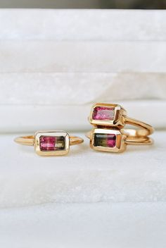 Emerald cut Watermelon Tourmaline Bi-Color: Red/Green A+Stone is set in 18k gold overlay Smooth finish Please note the stones are natural so no two stones will