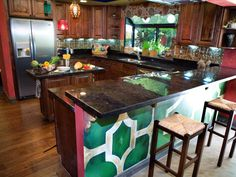 This colorful eclectic kitchen, designed by HGTV Design Star contestant Jason Champion, features warm wood cabinetry, marble countertops, caned barstools and colorful Moroccan pendant lights.