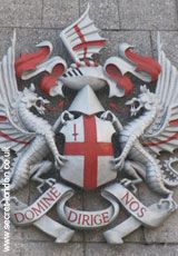 City Of London    These arms predate the formation of the College Of Arms, so there is some confusion about their origin. The Cross is St George (who the dragons also allude to)  with the sword of St Paul in one corner. 'Domine Dirige Nos' means 'Lord Direct Us'.     Guildhall EC2  Tel: +44 (0)20 7332 1460  Tube: Bank