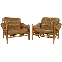 Pair Of Safari Leather Armchairs By Arne Norell For Scanfom | From a unique collection of antique and modern lounge chairs at http://www.1stdibs.com/furniture/seating/lounge-chairs/