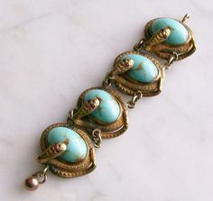 I think I need to have this...Antique Victorian Watch Fob Snakes Turquoise Glass by Takingshape, $125.00