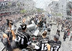 Jordan Nolan #71 of the Los Angeles Kings waves to fans in the midst of confetti falling down during the Los Angeles Kings Stanley Cup Victory Parade on June 14, 2012 in Los Angeles, California. (Photo by Victor Decolongon/Getty Images)
