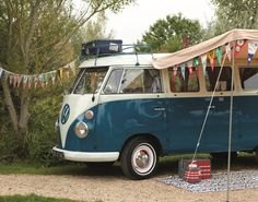 Note: bring decorative flags next camping trip (and a really cool VW bus!) / VW