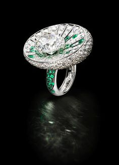 White gold ring set with a 10.15-carat round diamond, 84 emeralds (1.20 carats) and 387 white diamonds (8.97 carats) by de Grisogono