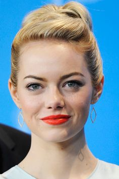 Emma Stone: 8 Ways to Make A Sizzling Statement With Poppy Red Lipstick.   Orange lipstick is making a name for itself in the fashion world! So many celebs are sporting this new look and we can't blame them! It's genius.
