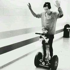 Is harry teaching him to ride a segway!!?! OH that is soooo cute!!