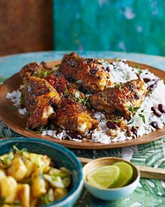 We've made this Jamaican favourite a little bit more special with a fabulous homemade jerk marinade, coconut rice and and a fresh pineapple salsa – wonderful fare for the weekend. Chicken Rice And Peas, Jerk Chicken And Rice, Jamaican Chicken, Coconut Chicken, Butter Chicken, Jerk Marinade, Pineapple Salsa, Pineapple Chicken, Jamaican Recipes