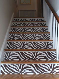 zebra pattern painted on wooden stairs risers! Only I would get this lol not really but its super cute! ; )