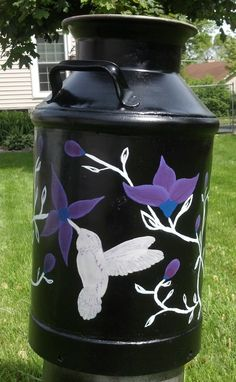 Milk jug painting adds instant personality to a vintage item.