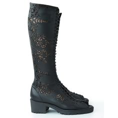 Open toe boots inspired by Islamic art. Made from natural black leather…