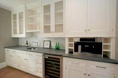 White kitchen cabinets, concrete countertop, grey backsplash