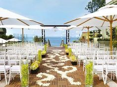 Umbrellas can protect guests from the hot sun during a beach wedding ceremony ~ Bridal Guide Malaysia