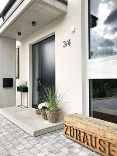 Our entrance area from the outside! # facade # new building # . , Our entrance area from the outside! new building # entrance # exposed concrete # wooden bench # facade. Concrete Facade, Exposed Concrete, Porch Light Timer, Building Facade, Porch Lighting, House Entrance, Sweet Home, New Homes, Patio