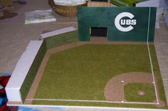 """From Mike Patterson: """"Lifelong Cubs fan that has always dreamed of chasing down fly balls in left field at Wrigley (hence the move of the Green Monster to right field). The field is a work in progress as I am currently working on bleachers in left, the batter's eye foliage in center and a Wrigley-esque scoreboard. I chose to include a Green Monster type wall in right, because A) I wanted to hide a dice tower and B) it sets Fenway apart from every other field."""" @Chicago Cubs #stratomatic"""