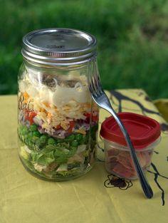 seven layer salad in a mason jar